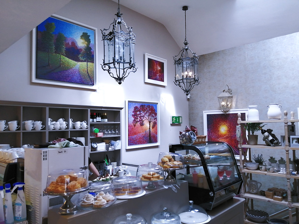 Some larger painting by Chris Quinlan Art in The Loft Cafe