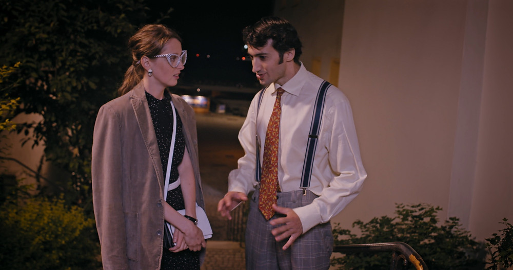 Two people whom have never dated before, come together for a romantic evening filled with humorous charm. They are seen talking in this still from the film.