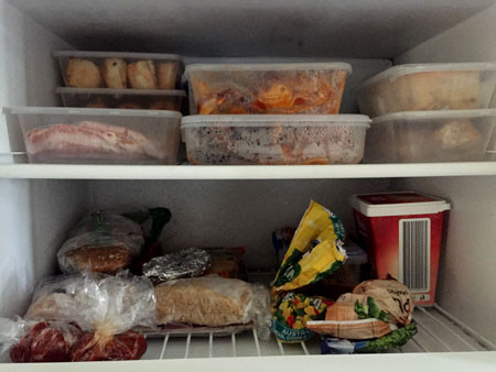 The top shelf of the freezer is stocked with homemade goodies.