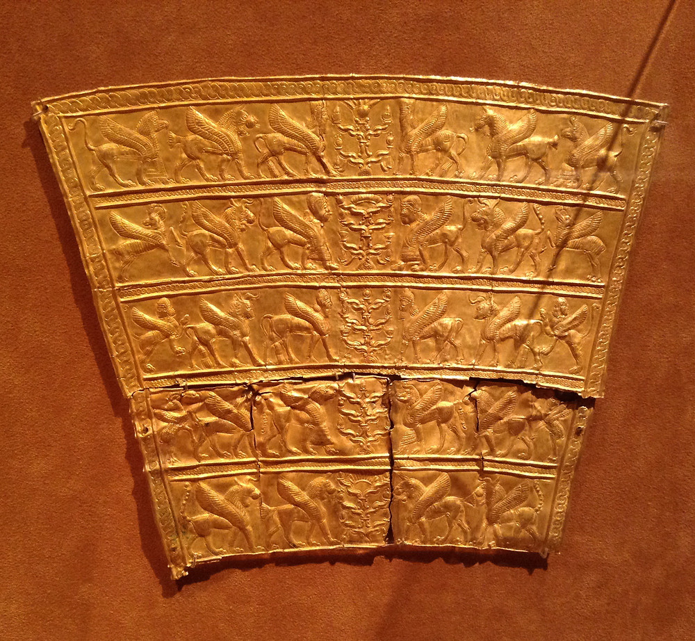 Assyrian King pectoral necklet showing winged creatures