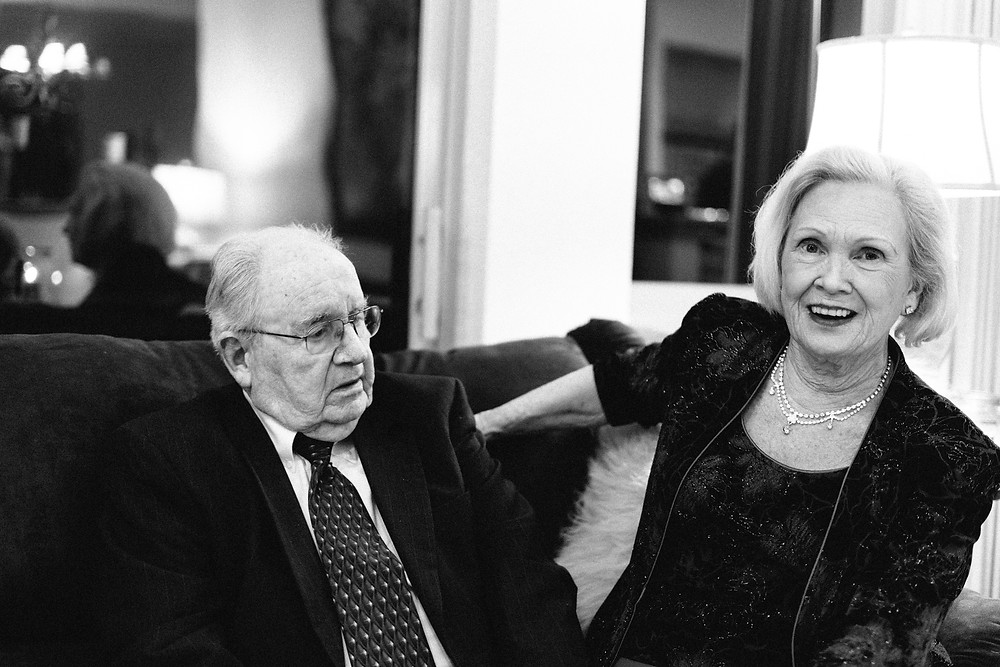 Elderly couple seated on the couch together