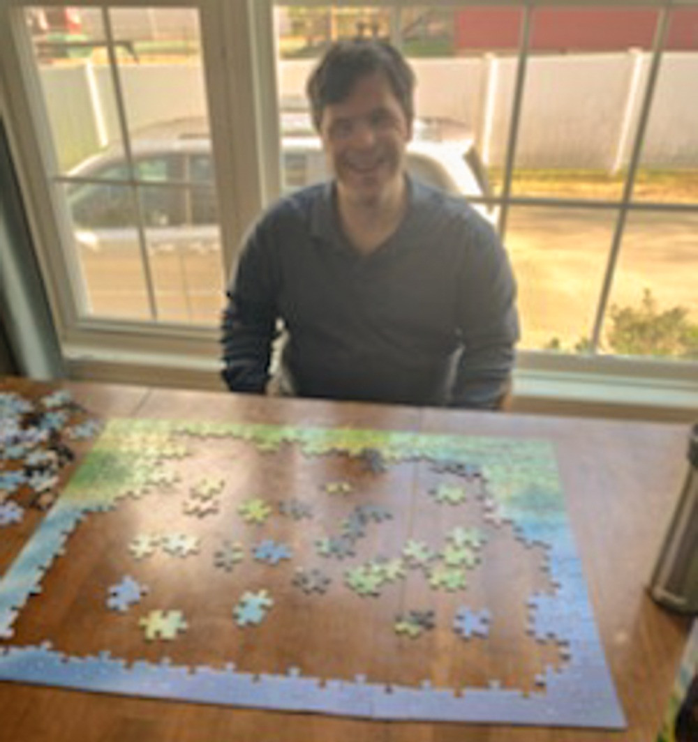 David, an individual in MARCs residential and day program, enjoys a puzzle during qurantine.