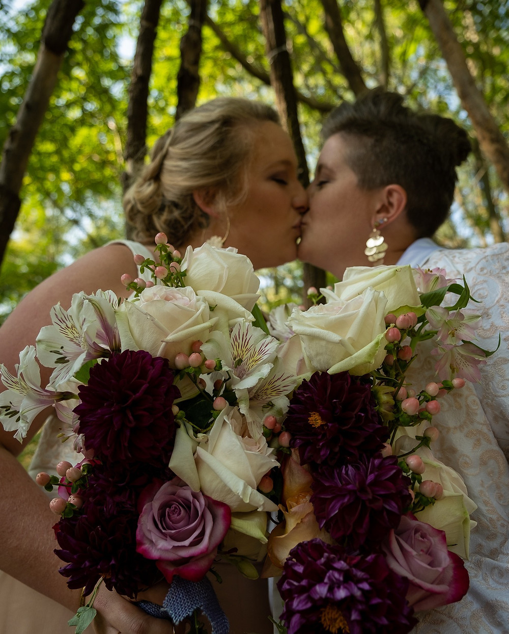 Two Brides Kiss After Exchanging Vows