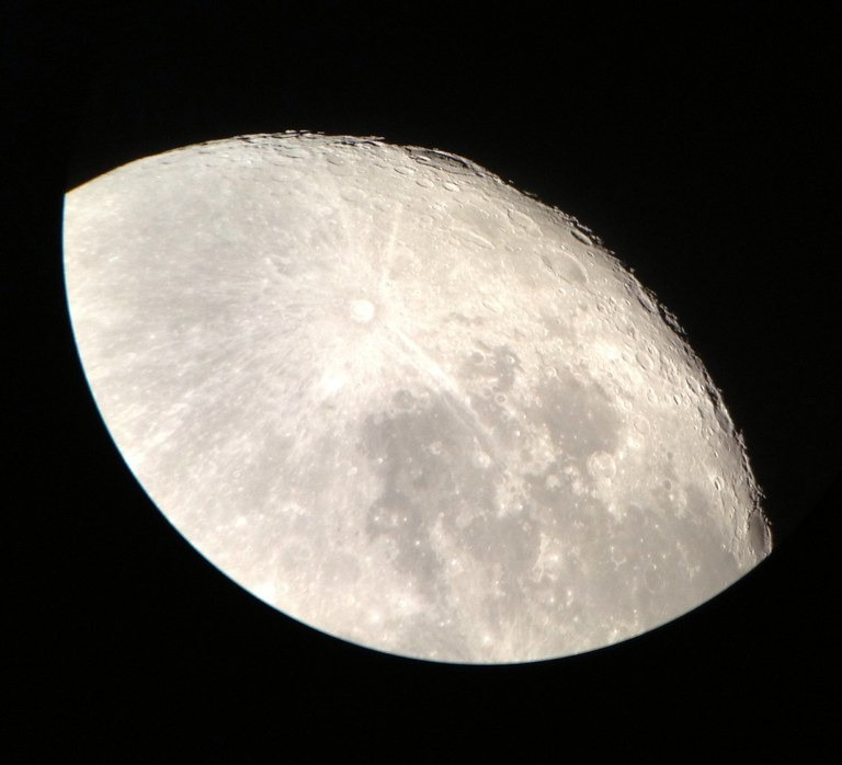 Astrophotography with a smartphone, and a telescope adapter mount.