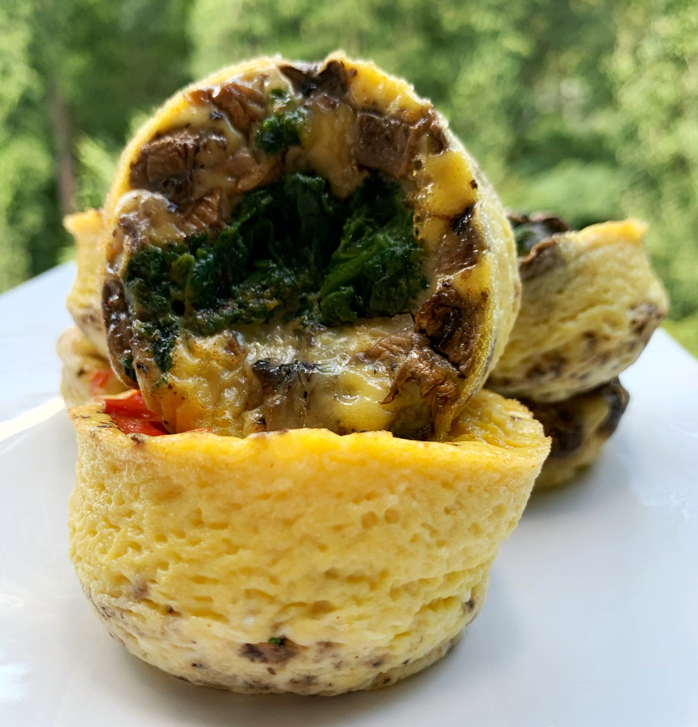 mini frittatas stacked on each other with mushrooms and spinach