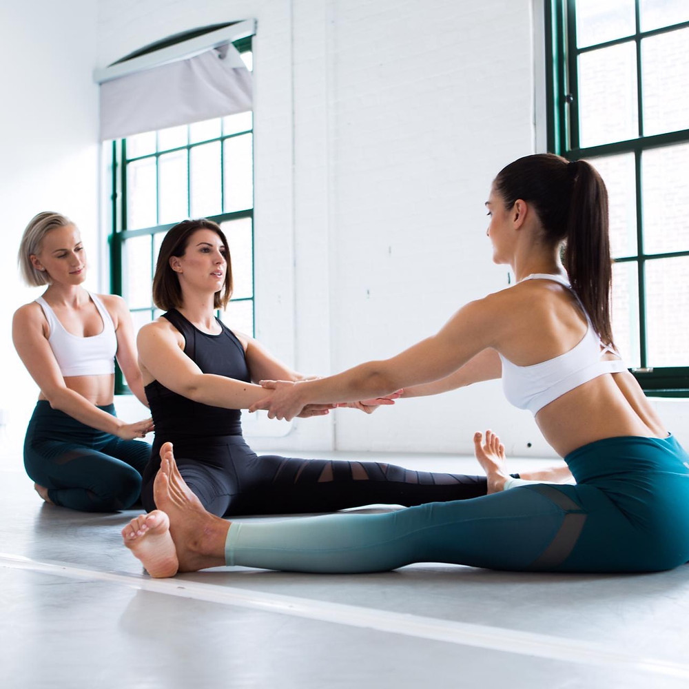 Jemma and Zhana stretching their student in class