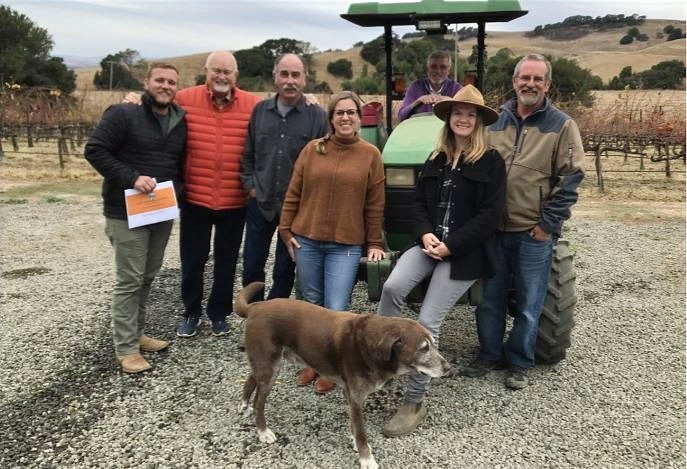 Save the Family Farms Napa Valley is seeking a micro winery designation that would allow wine tasting and sales at small farms. Meeting recently were (left to right) Zach Smith of Calistoga's Barlow Vineyards; Terry Scott, Ken Nerlove, Elise Nerlove, George O'Meara, Hayley Hossfeld and Barr Smith. Photo by Pat Hampton.