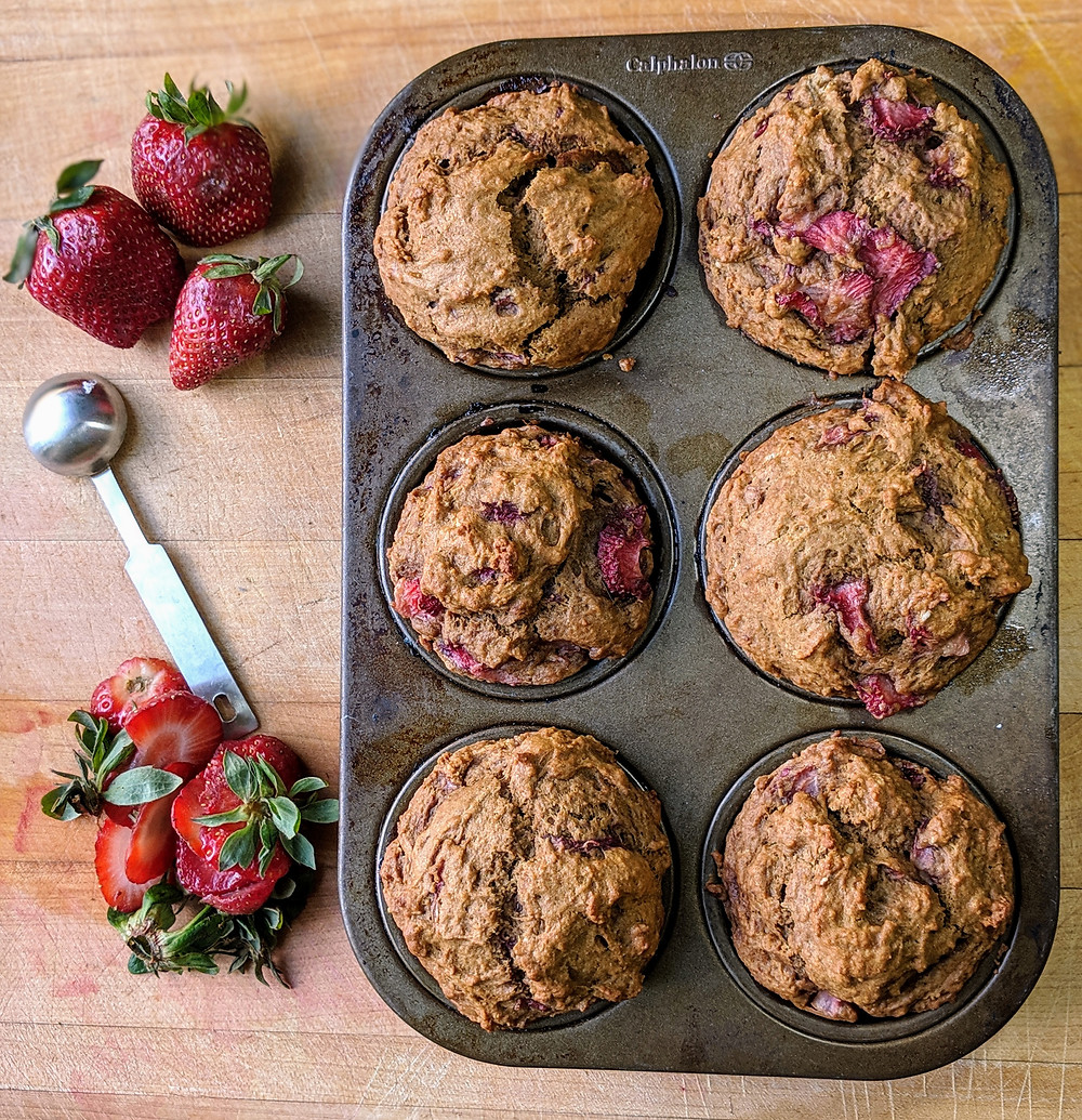 A pan of lightly golden strawberry muffins