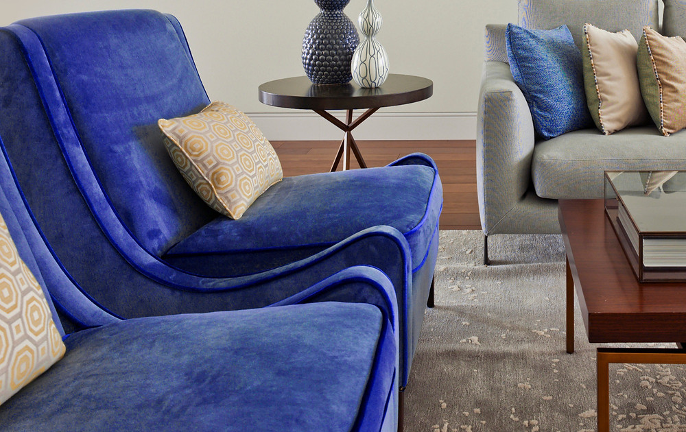 Two blue suede chairs