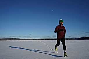 Canva - Man Running on Ice Covered Land.