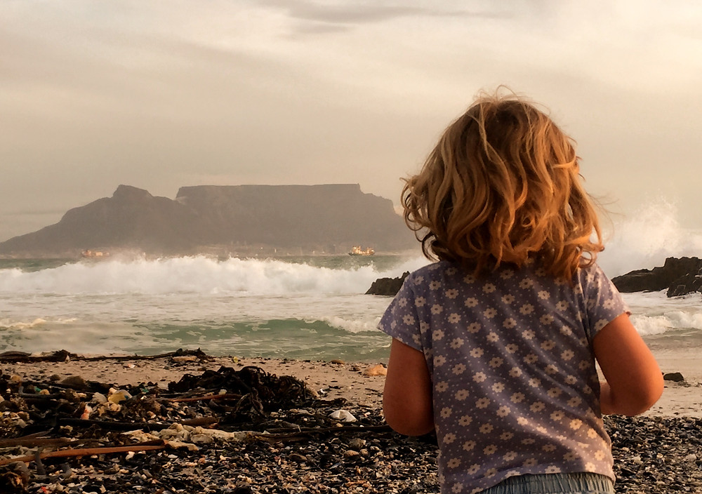 Little girl infront of Tabel Mountain South Africa. Table bay . View from Blouberg Beach.