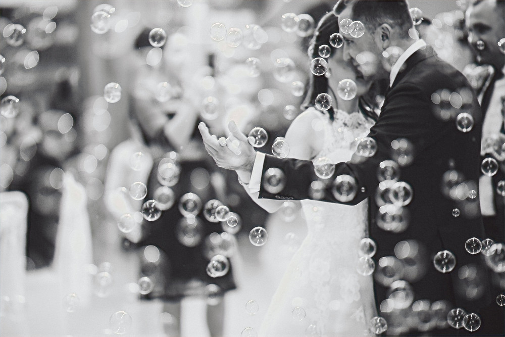 Wedding couple on the dance floor with bubbles