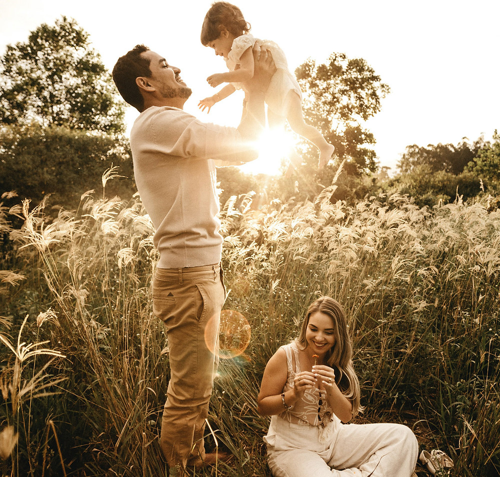 Bright Future and a Hope Family in tall grass, Father with daughter, relaxing, summer