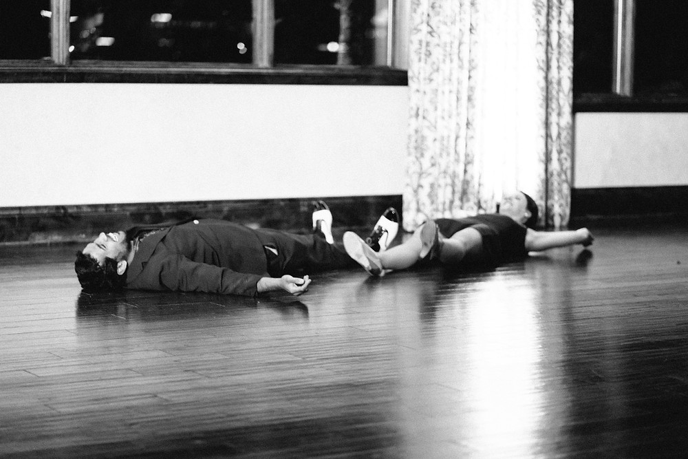 Dancers exhausted on the floor after a showcase dance
