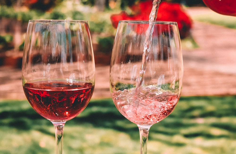 Pouring two glasses of rosé