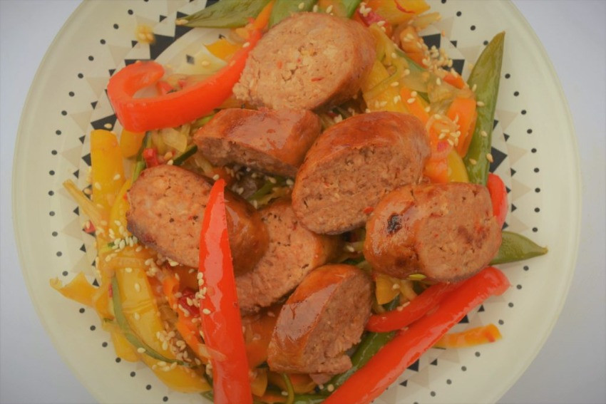 Healthy sausage stir fry on a plate <img>