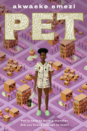 A black girl in her pajamas holds a feather in front of a map of her town