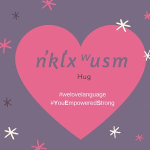 A heart with the nsyilxcen word for 'hug'