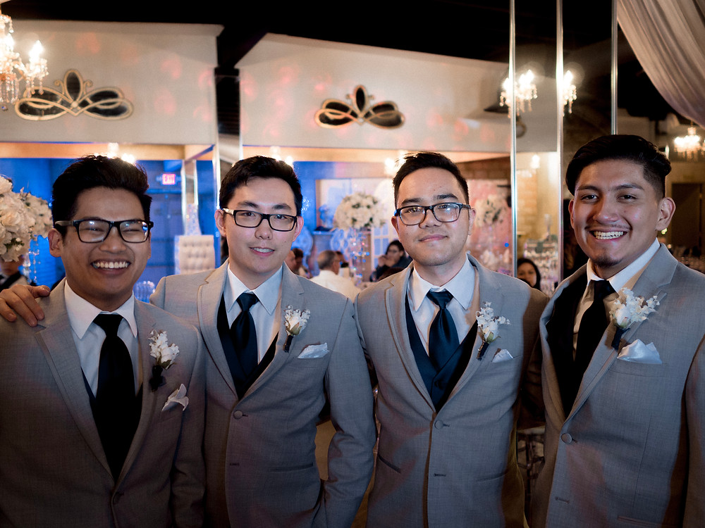Groomsmen smiling at the camera before the ceremony
