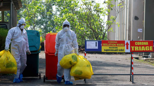 Health officials wearing protective clothing carry medical waste out of an isolation ward at the Ernakulam Medical College in Kochi, India, on February 8, 2020. Robotic biohazardous waste removal has been promoted by experts in the U.S., including Texas A&M computer science and engineering professor Dr. Robin Murphy, an emergency response robotics advisor, who had direct experience with the 2015 Ebola outbreak in the U.S. ARUN CHANDRABOSE | AFP via Getty Images