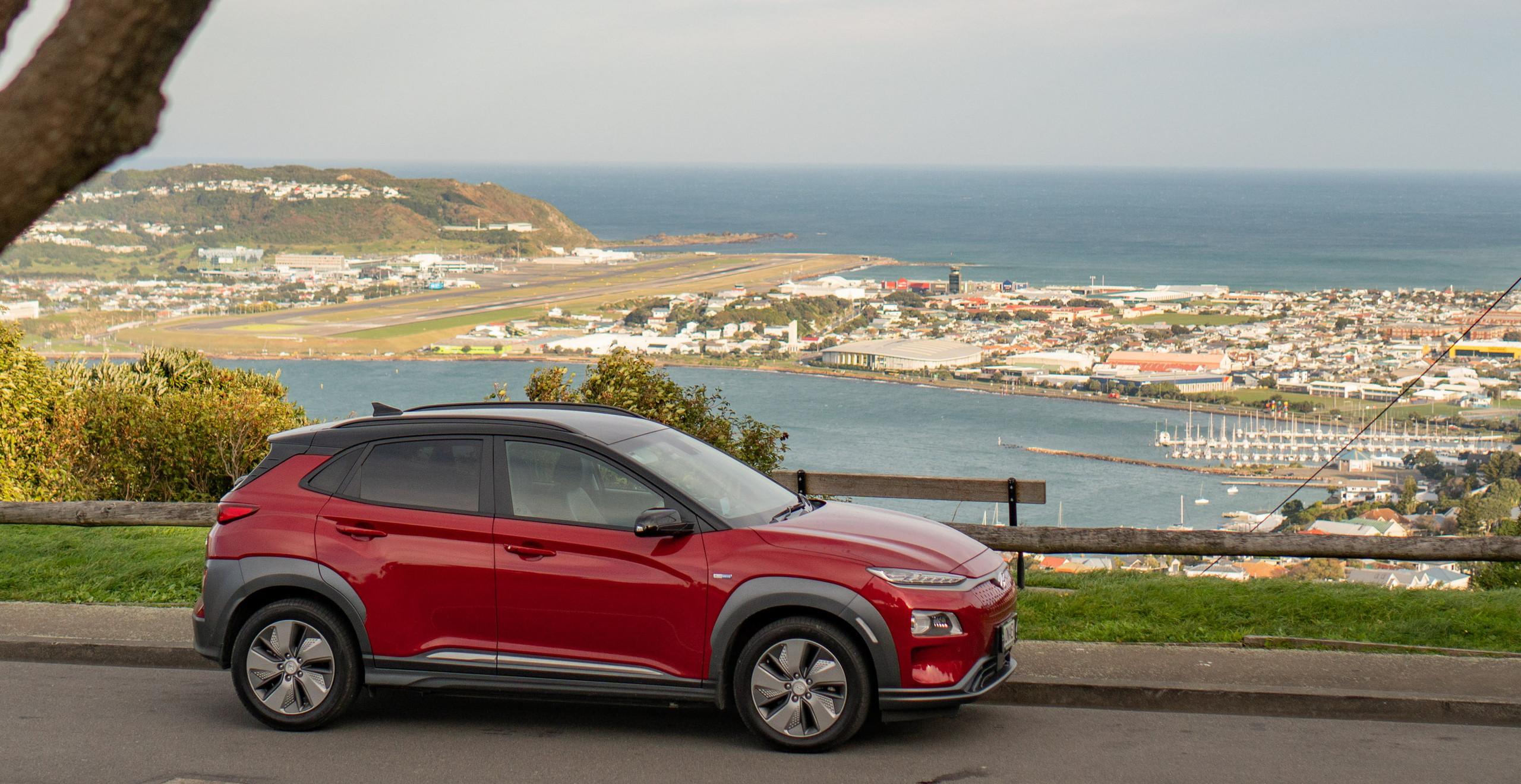 Hyundai Kona Electric 2019 front exterior red Wellington New Zealand skyline airport