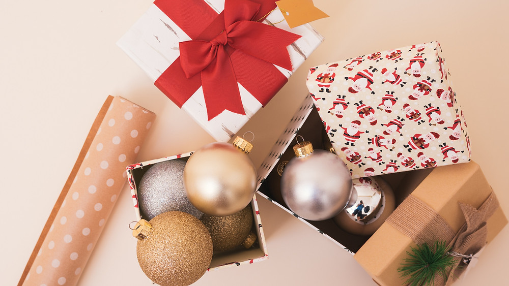 Wrapping paper and Christmas decorations in a box