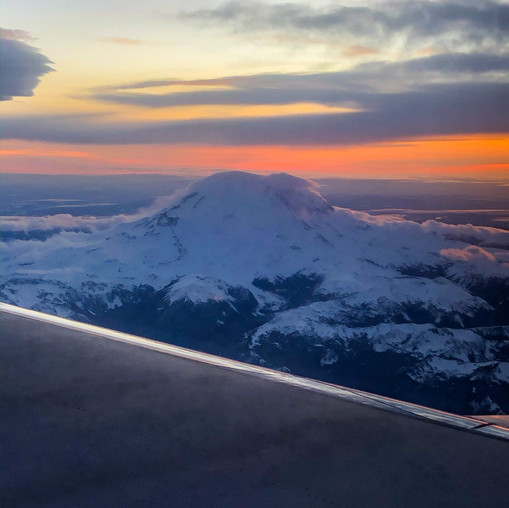 Mount Rainier at sunset from an airplane