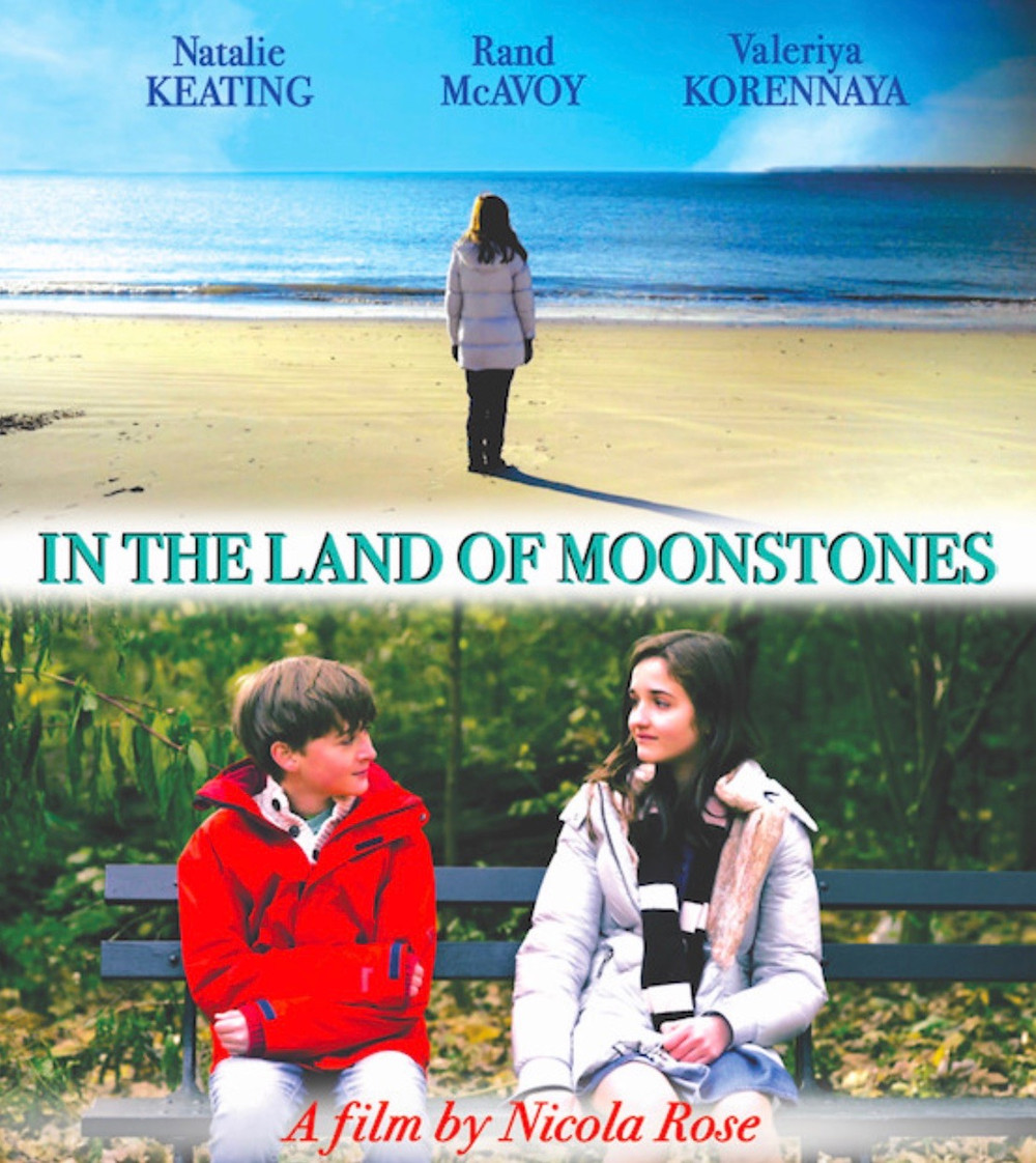 This image has seemingly been spit onto two halves; the top half shows a girl standing on a beach, only metres away from the sea, with her back turned to face the camera. The bottom half shows the same girl but this time sitting with a boy on a part bench, a mass scene of greenery can be spotted behind them as they look at each other.