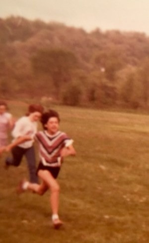 Me (in front with the brown dress shoes) during my elementary school's field day races.