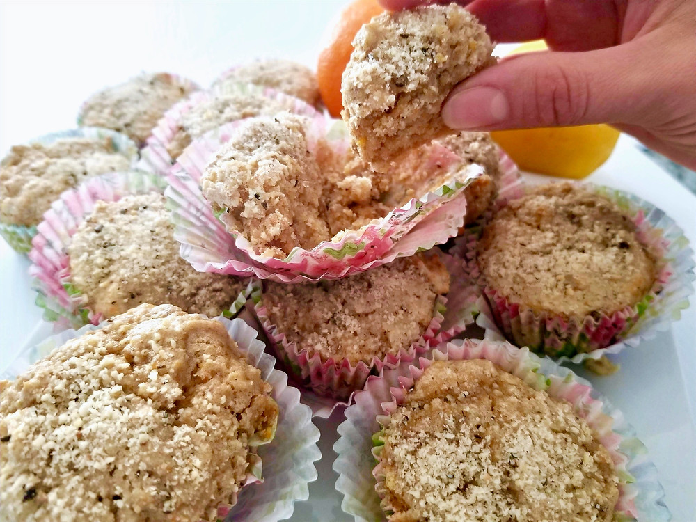 Hand holding fresh-baked citrus chickpea muffins