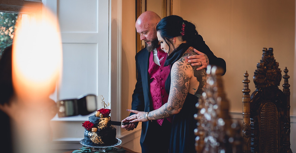 Inked Bride and Groom Cutting Cake