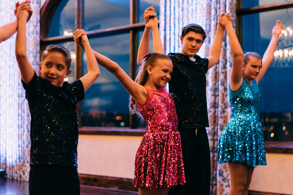 Kids taking a bow after their showcase dance