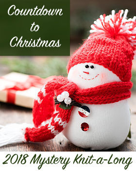 Knit snowman wearing a scarf & hat with the text: Countdown to Christmas 2018 Mystery Knit-a-Long