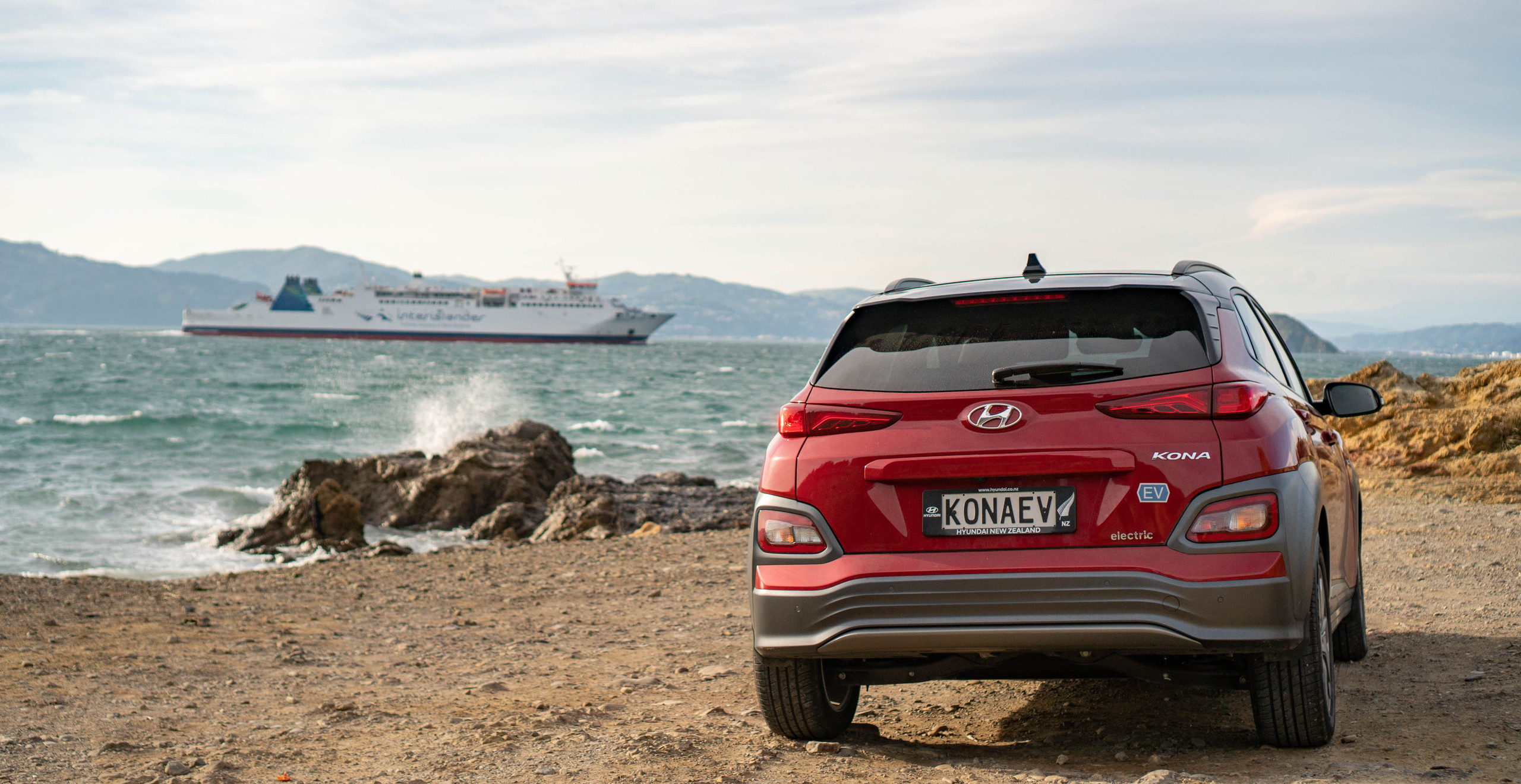 Hyundai Kona Electric 2019 front exterior red Wellington New Zealand Interislander beach
