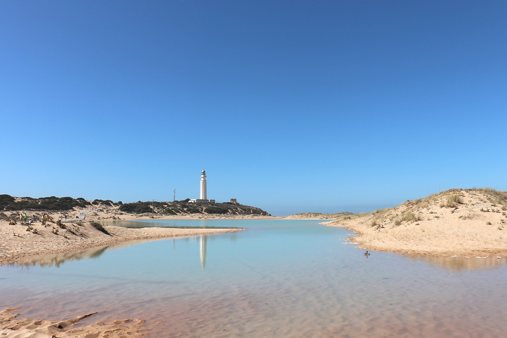 Playa del Faro de Trafalgar lighthouse in Cadiz, Spain