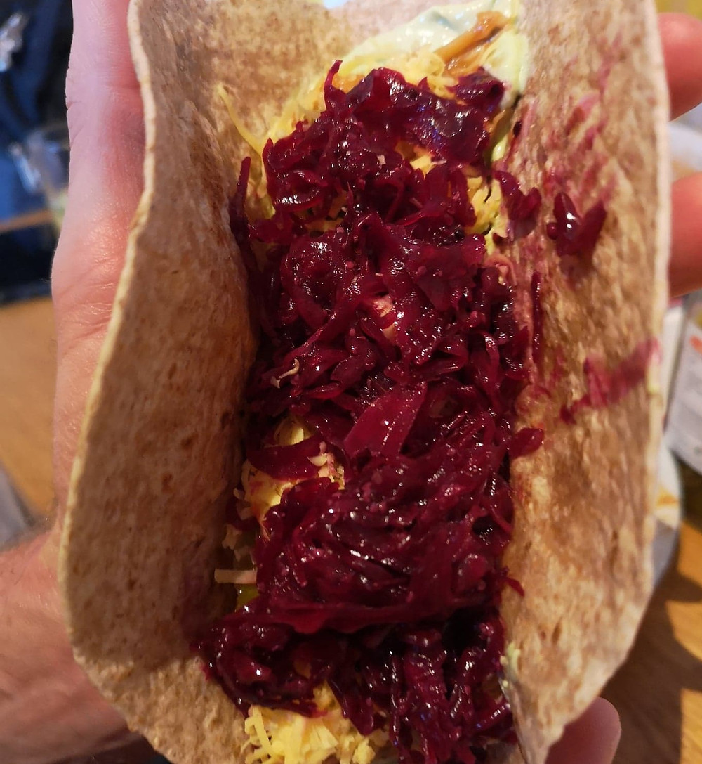 Tortilla filled with reclaimed red kraut and grated cheese