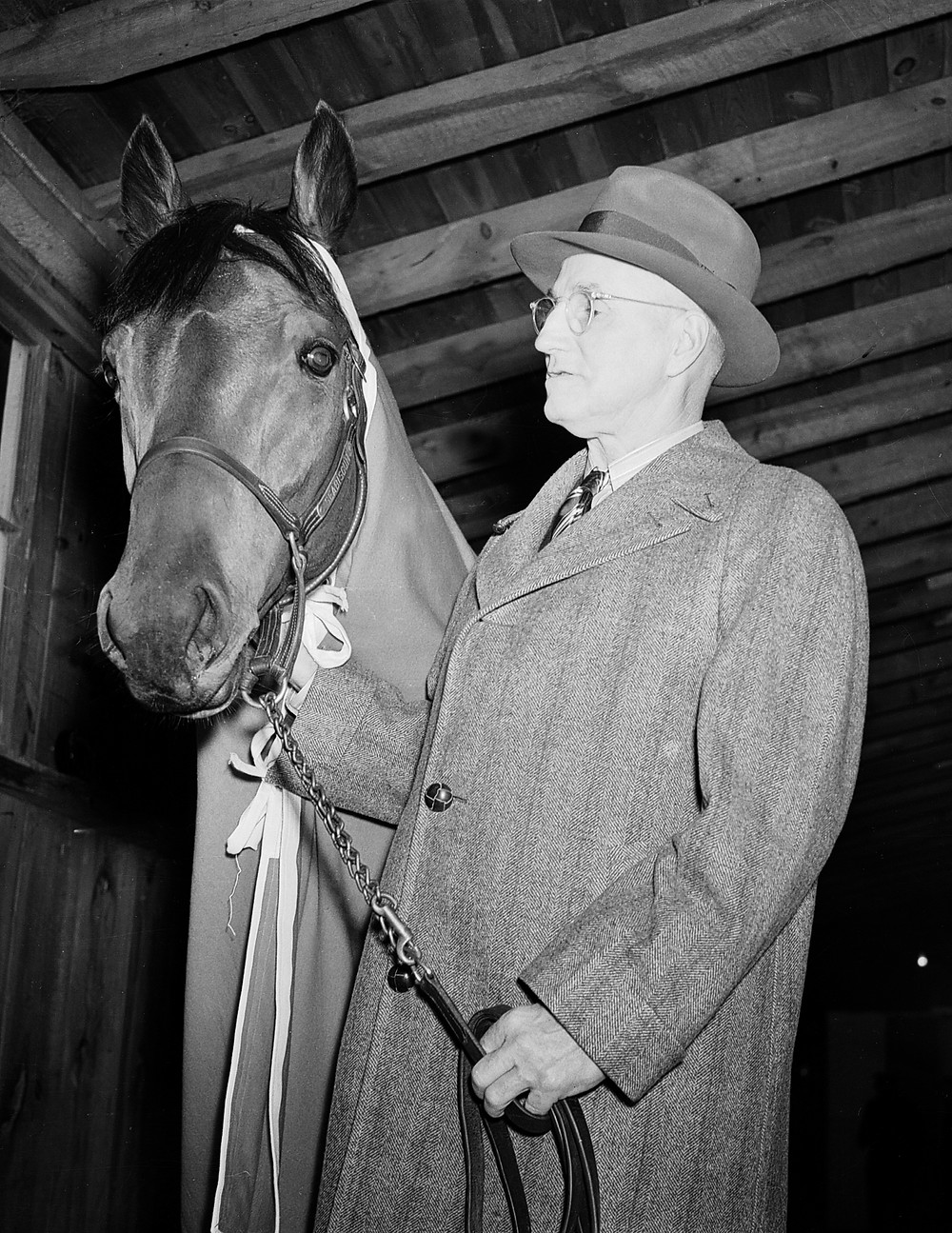 Seabiscuit and trainer Tom Smith after winning the 1938 Pimlico Special, the match race with War Admiral.