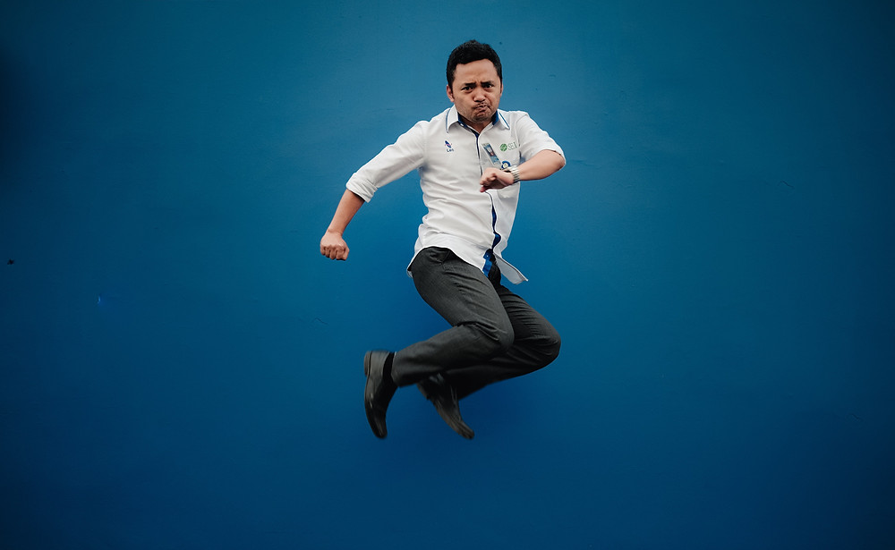 Man in professional attire jumping in the air happy because he has better access to counseling specialists while doing online therapy in Colorado. We can meet all of your counseling online in Denver CO 80209 and 80210