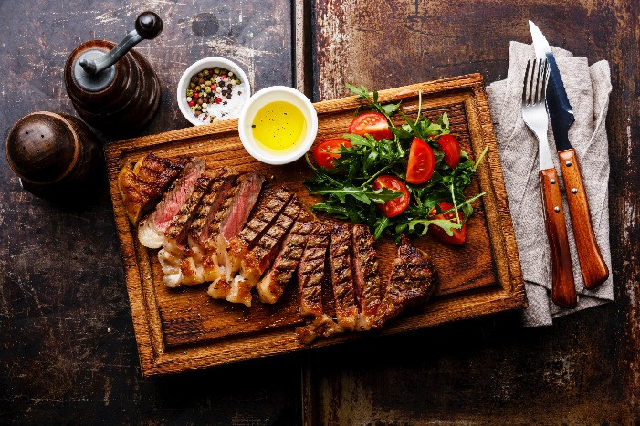 medium rare steak wood chopping board