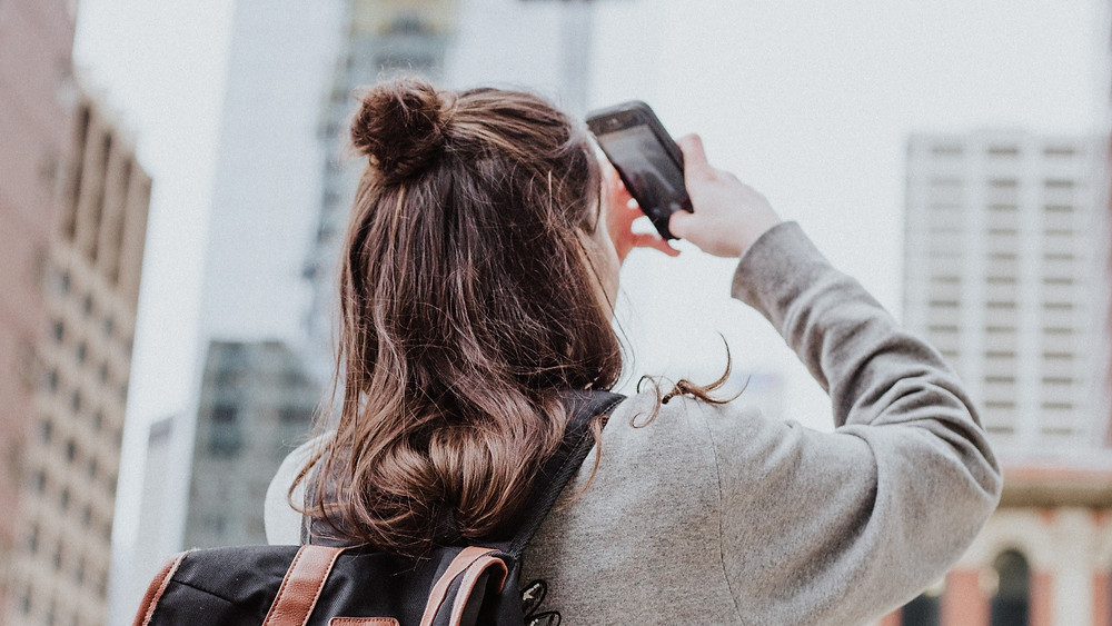 a woman takes a photo with her phone