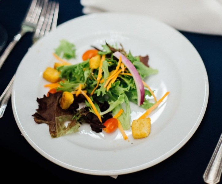 A close up of a plate of food served by Grillado restaurant