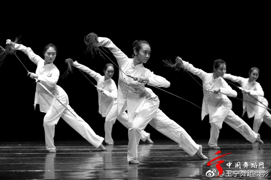 Chinese girls performing sword dance.