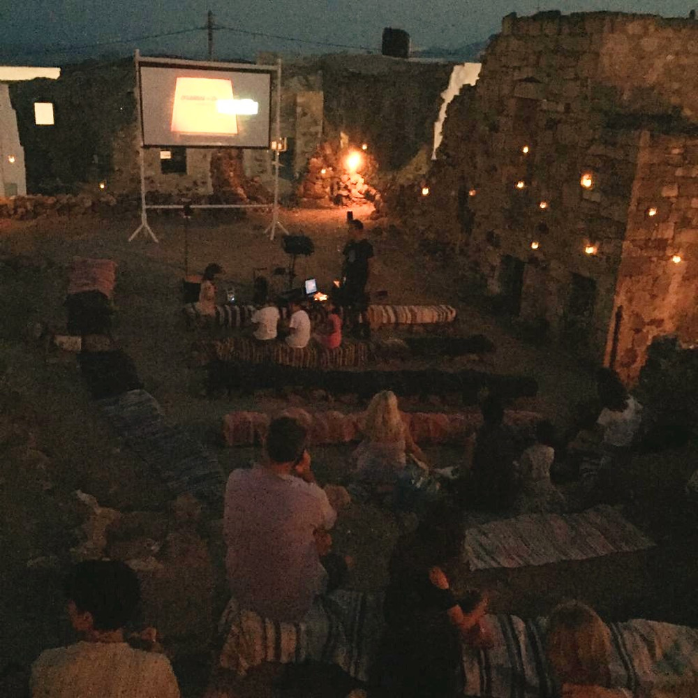 People watching a movie at an open-air cinema on Kimolos Island in Greece