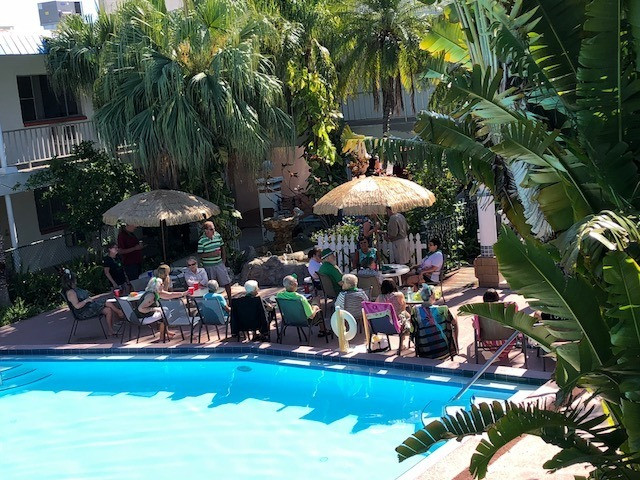 Arial view of guests in chairs at front of pool