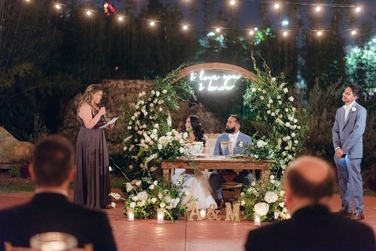 Star War's I Love You I Know floral wedding arch behind sweetheart table at Curtiss Mansion in Miami Springs