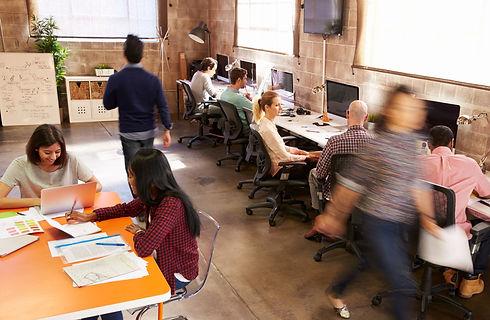people walking around office