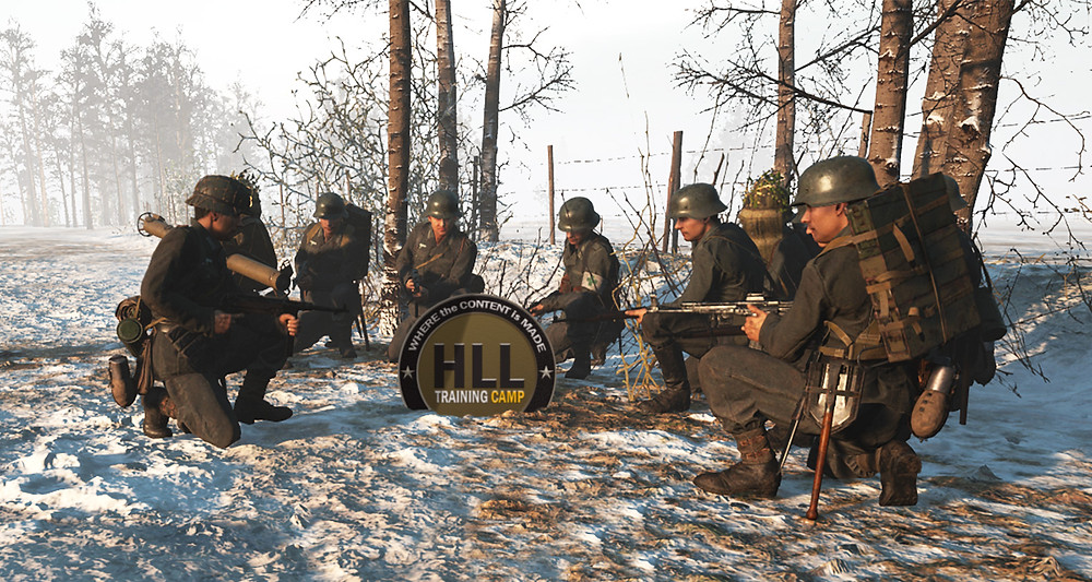 Hell Let Loose in-game screenshot of a few of the original HLLTC members taking a knee in-game to plan out a battle strategy for taking the next cap point. At the time, the HLLTC only had around 100 members. The HLL Training Camp now has many thousands.