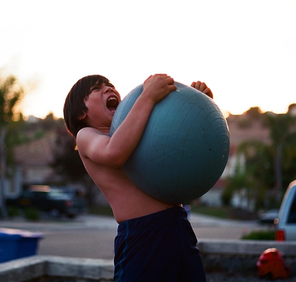 boy lifting atlas stone.