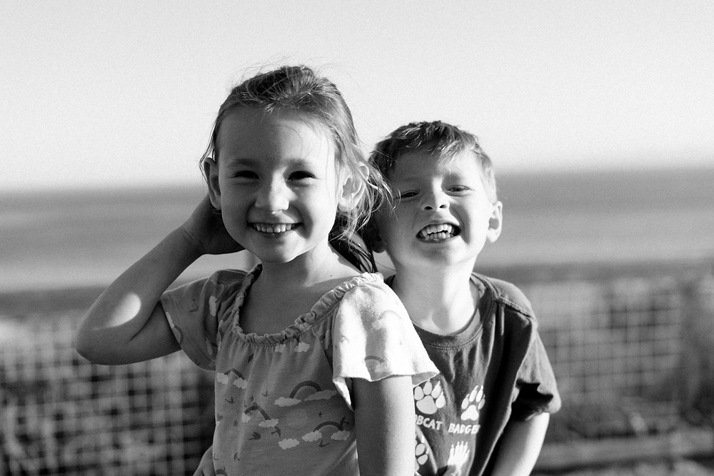 Young boy and girl smiling at the camera