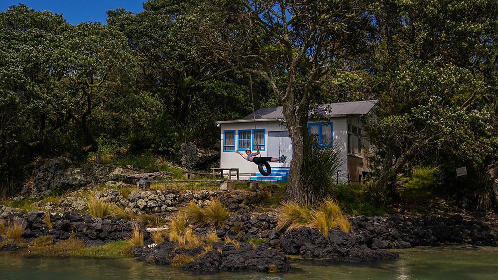 Woman on swing nature cabin island beach